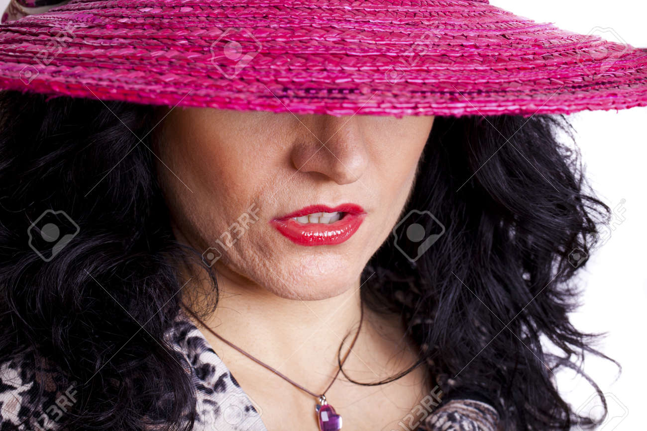 Portrait of sexy woman with fuxia hat. Stock Photo - 11859061
