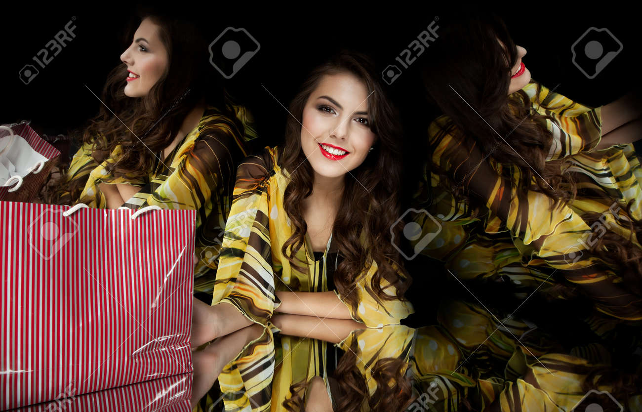brunette woman shopping bag kaleidoscope mirrors smiling Stock Photo - 9669496