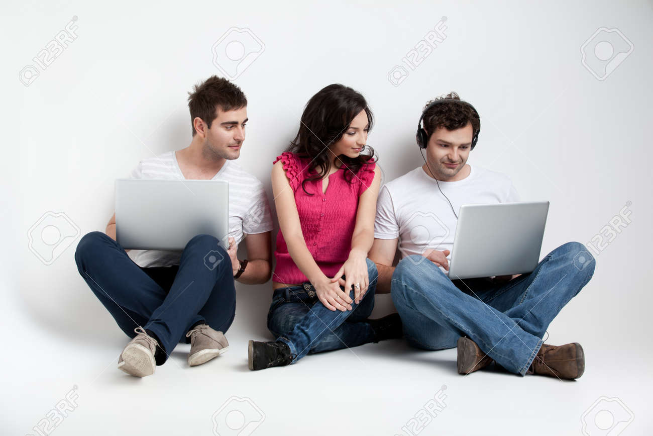 curious friends looking at laptop Stock Photo - 9667643