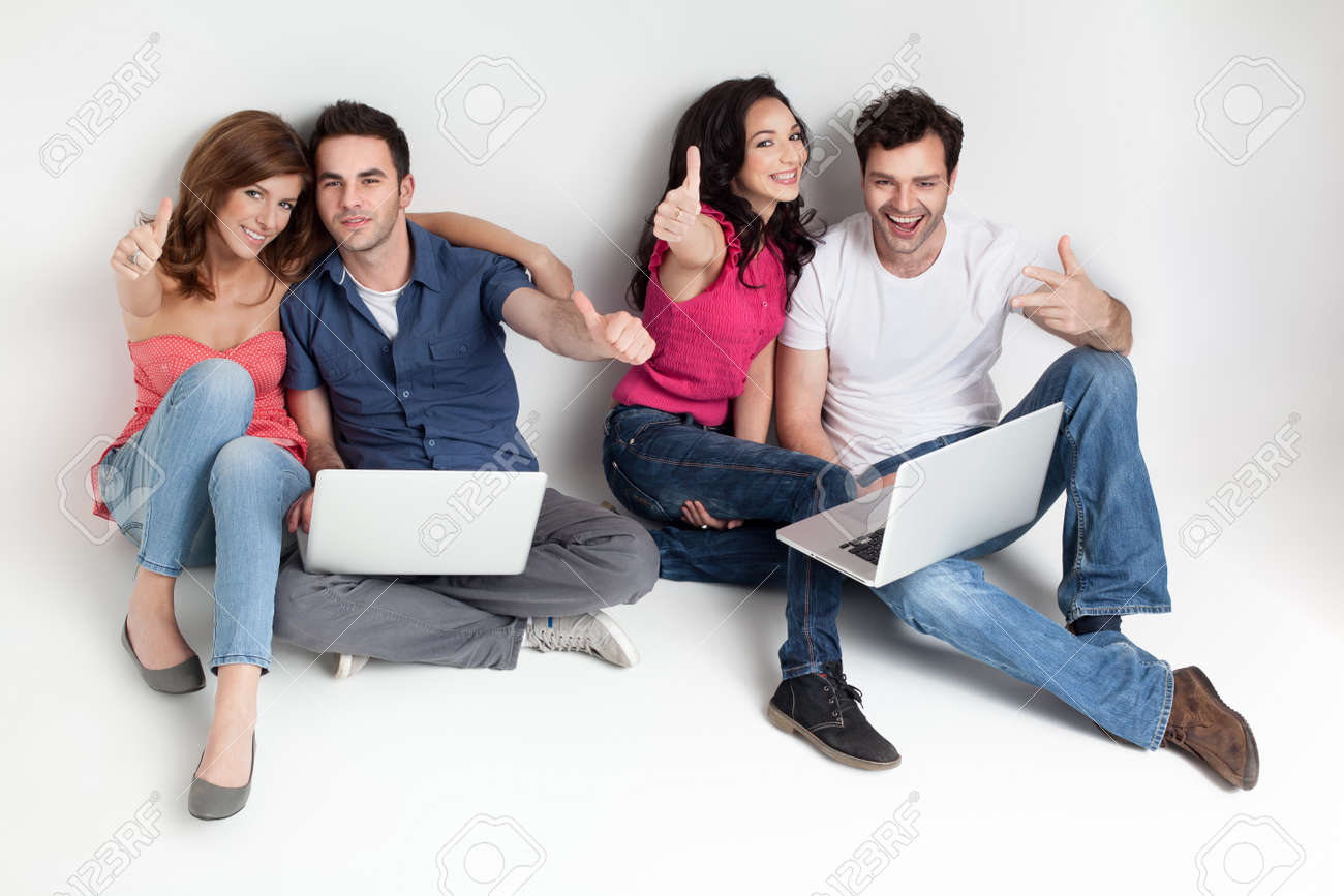 young group happy friends hoding aprooving laptops Stock Photo - 9667704