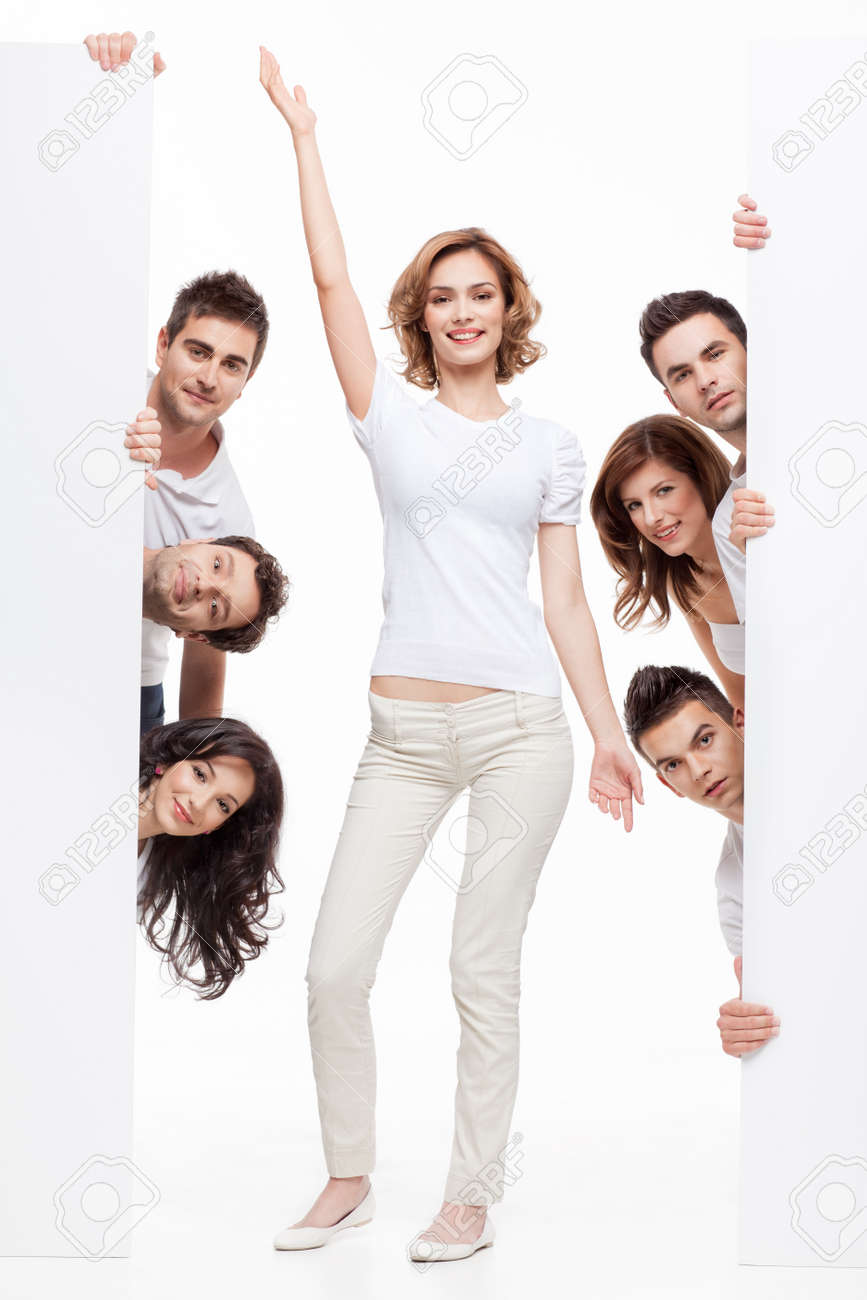 young woman posing between two white boards and friends Stock Photo - 9881621