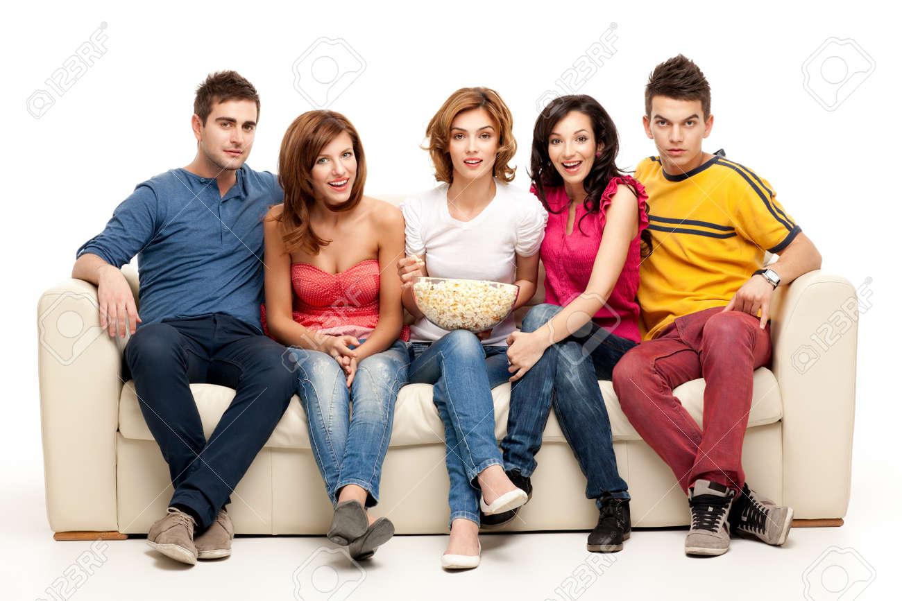 friends sitting on couch watching tv Stock Photo - 9887576