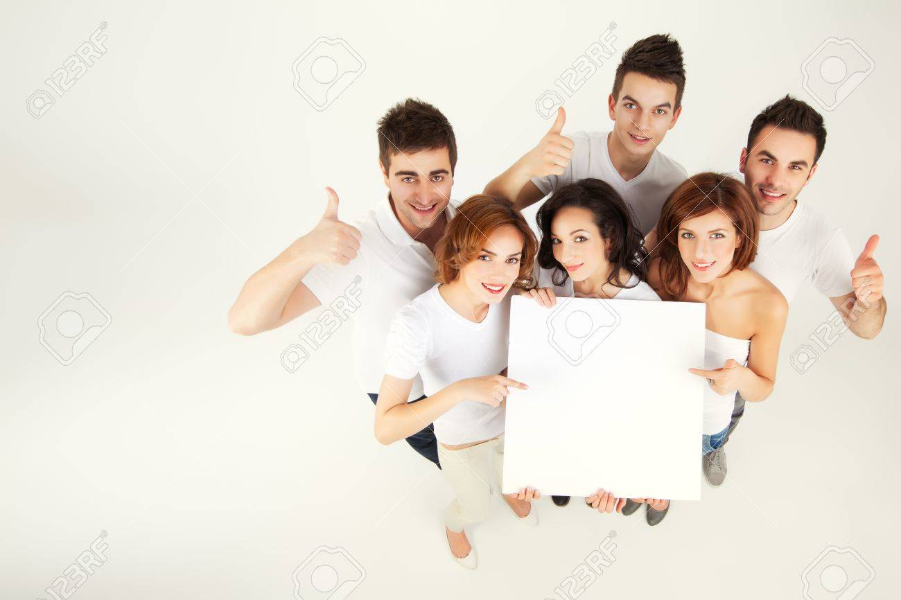 team of casual young people holing blank banner Stock Photo - 9887607