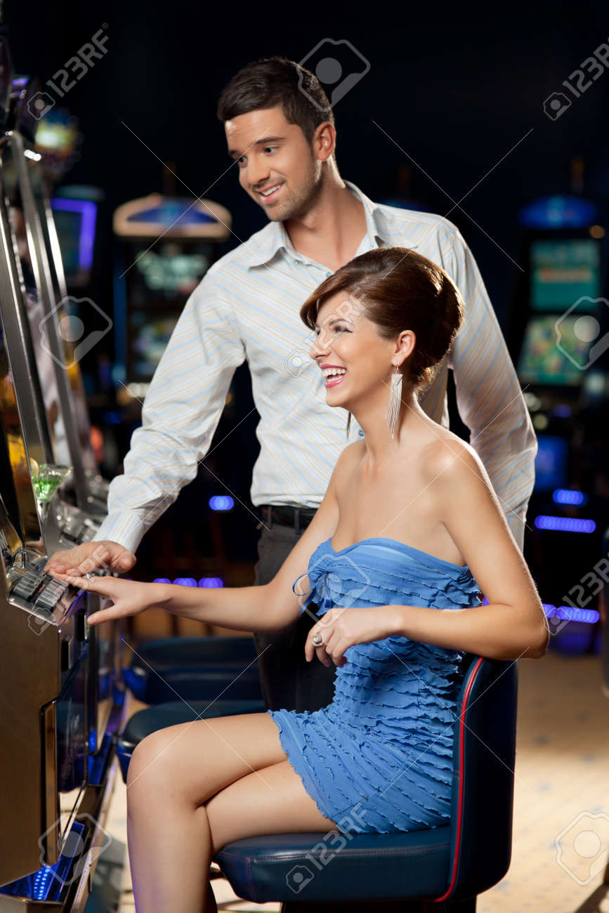 young couple playing together at slot machine Stock Photo - 10313877