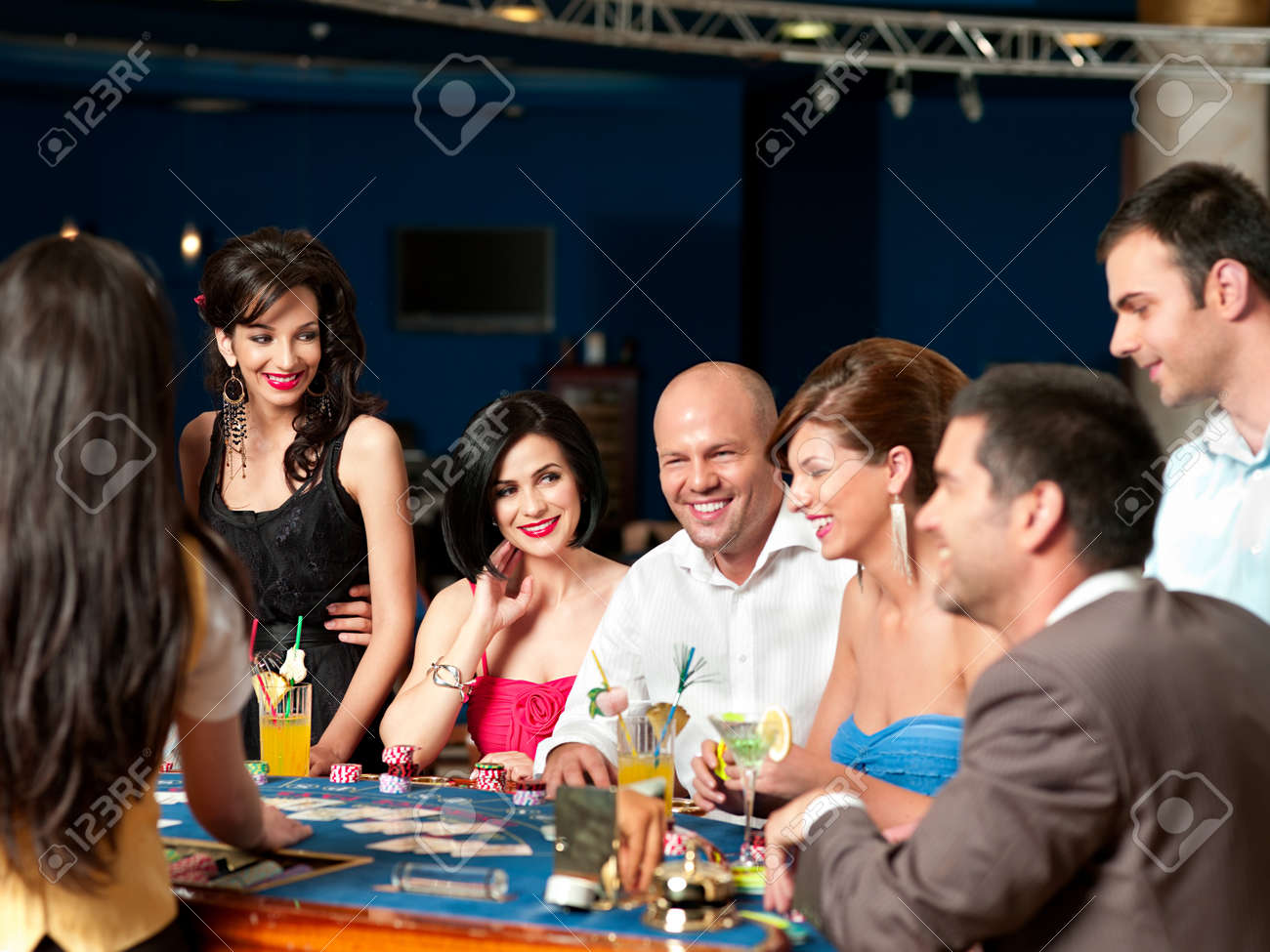 group of people playing blackjack or poker, smiling Stock Photo - 10297735