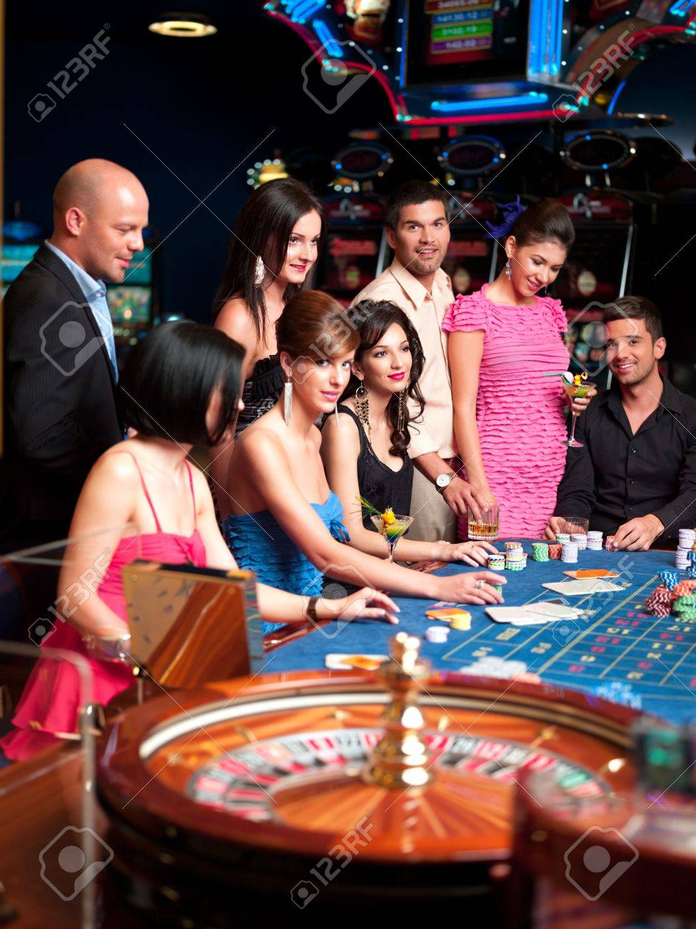 Group Of Casino Players Sitting At A Roulette Table Stock Photo, Picture  And Royalty Free Image. Image 10297737.