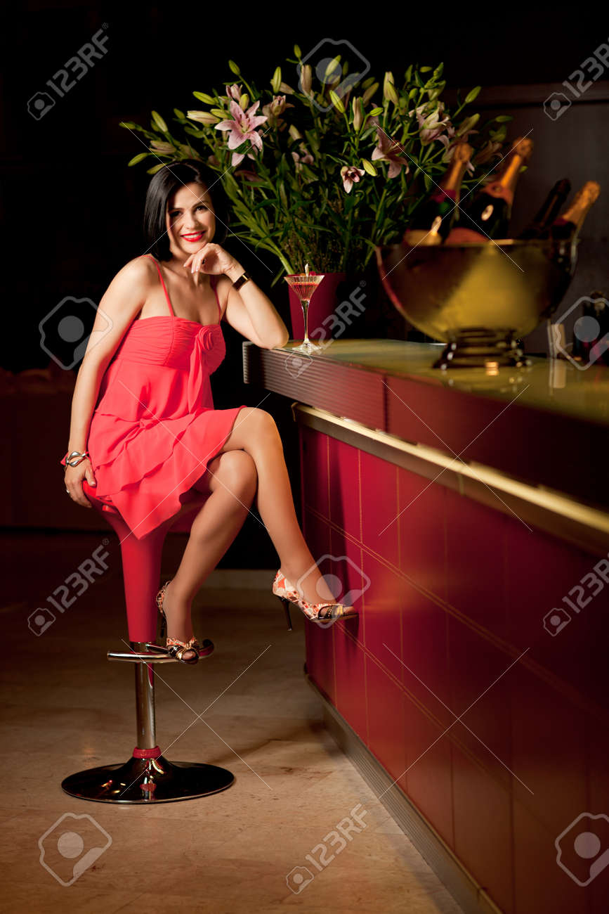 beautiful woman red dress bar counter smile Stock Photo - 10298307