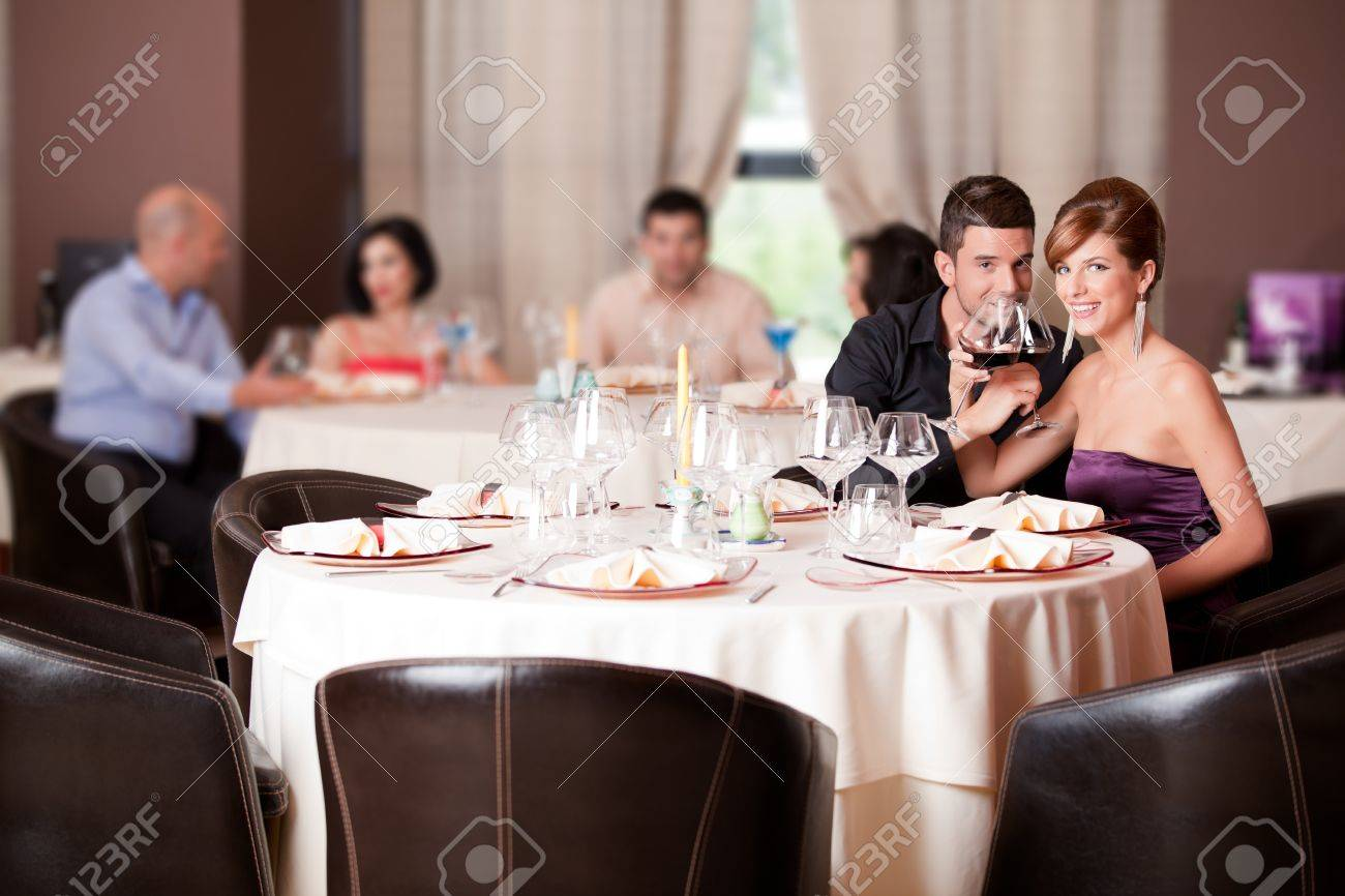 romantic young couple in restaurant date toast Stock Photo - 10298251
