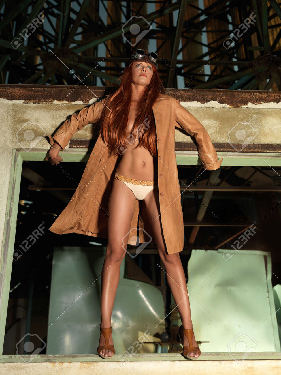 fashion portrait of beautiful, young woman, dressed in a vintage aviator outfit, standing in a window frame Stock Photo - 12025748