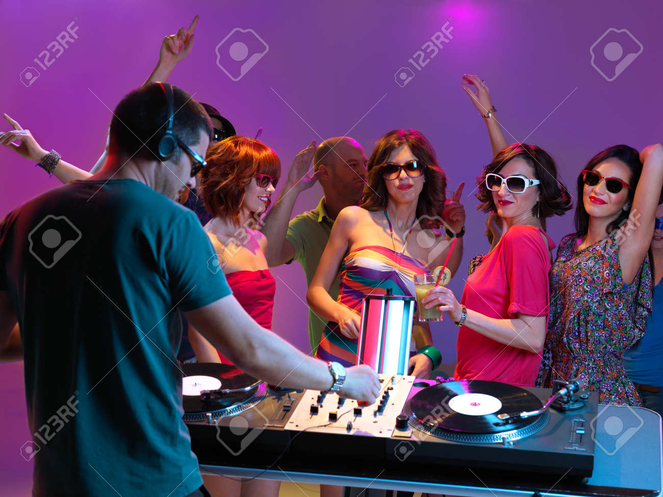 sexy, young women dancing and flirting with the dj in a night club Stock Photo - 14769834