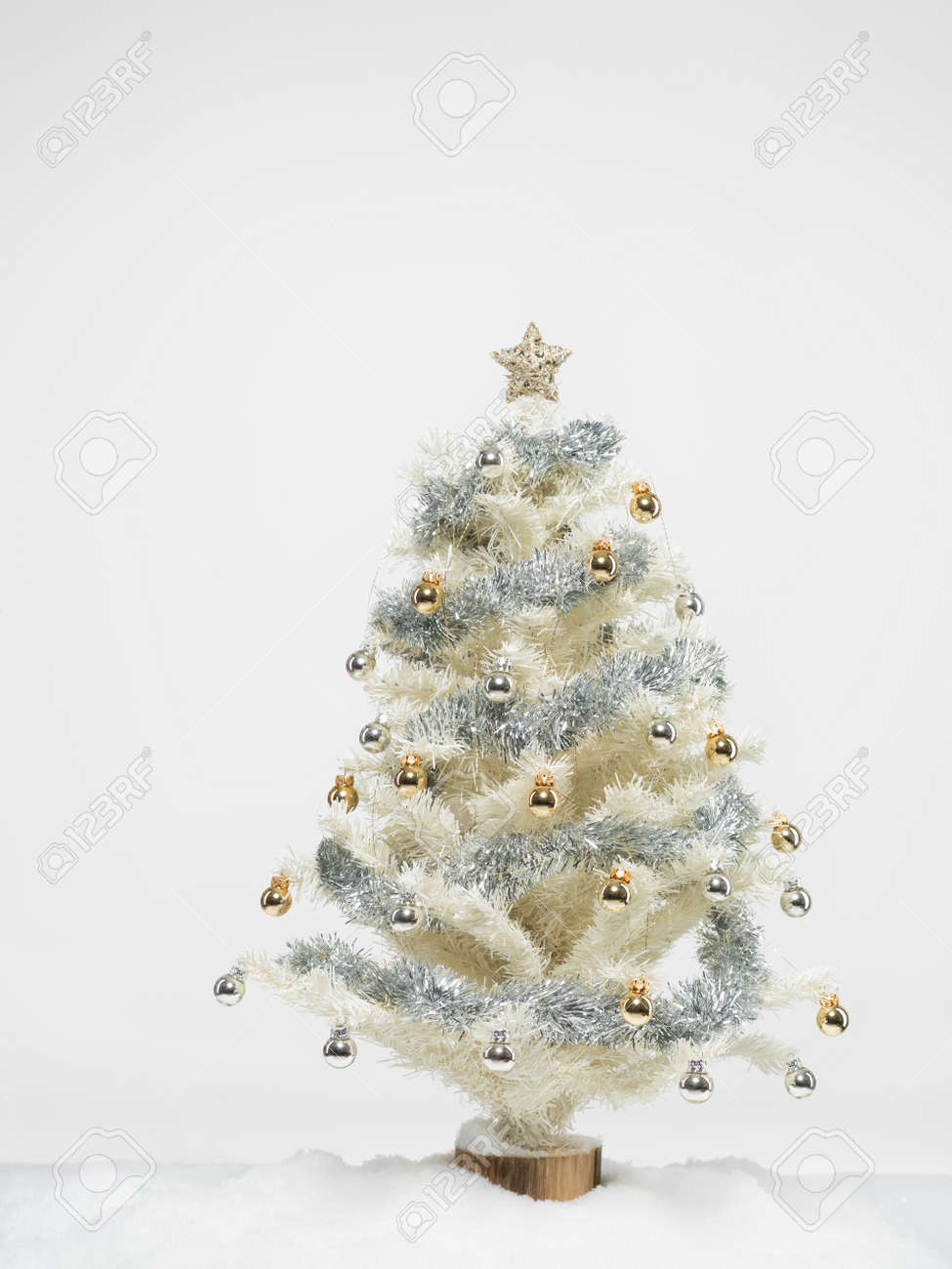 White Christmas Tree Beautifully Decorated With Shiny Golden Stock Photo Picture And Royalty Free Image Image 16776058