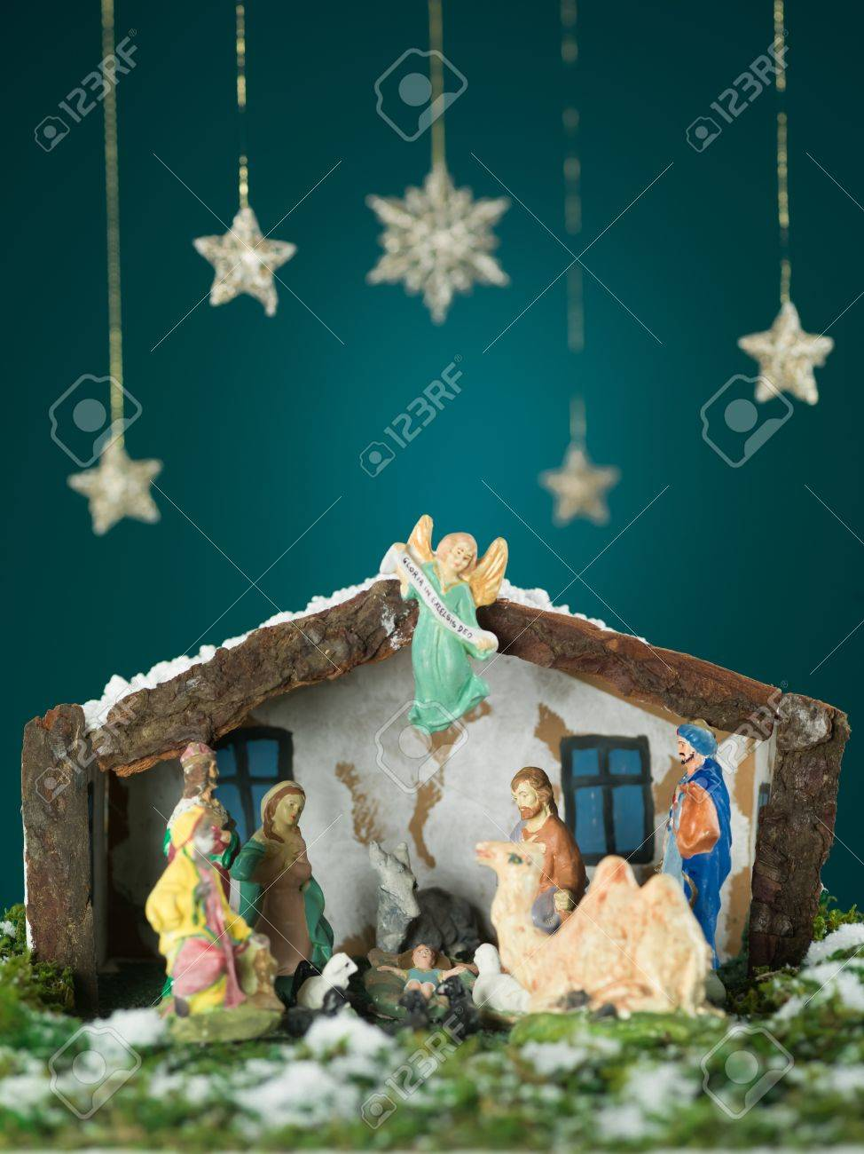 closeup of birth of baby jesus scene with wooden figurines snow