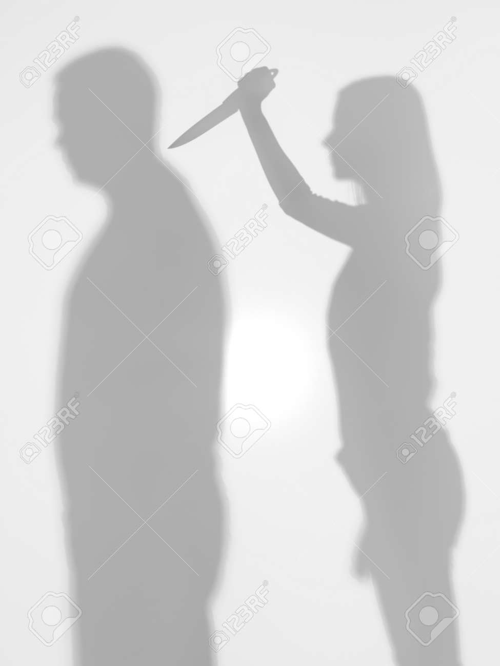 Stock Photo Body Silhouettes Standing From Profile, Woman Trying To Stab A  Man With A