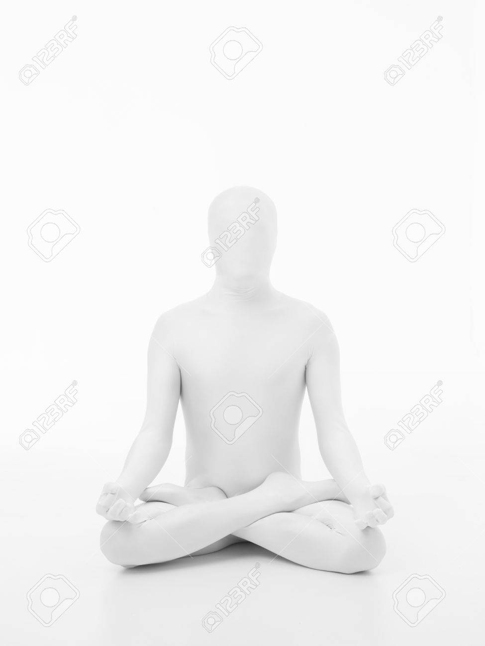 faceless man dressed in white sitting in yoga lotus position, front view Stock Photo - 28075846