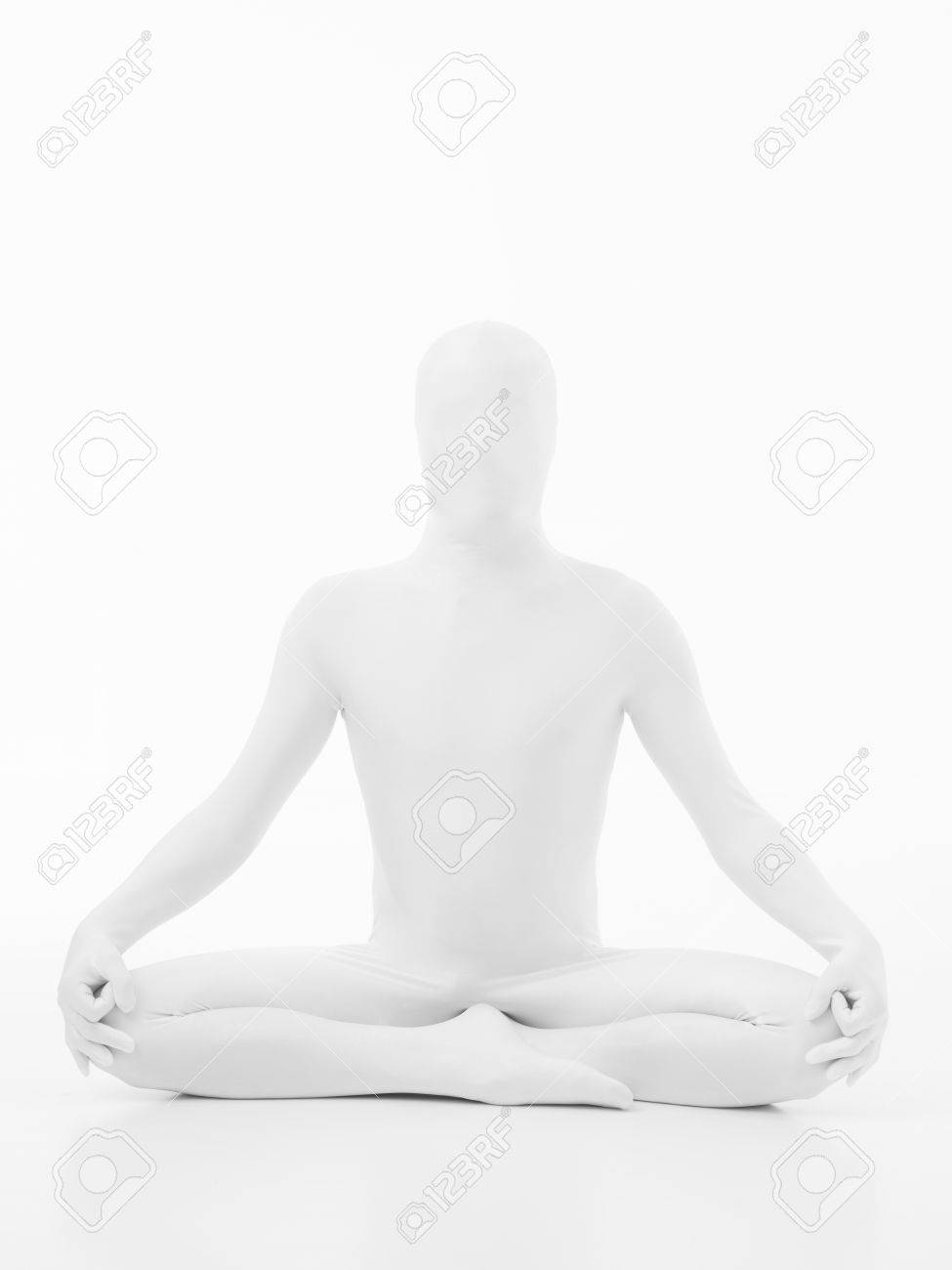 faceless man dressed in white sitting in yoga lotus position, front view Stock Photo - 28075847