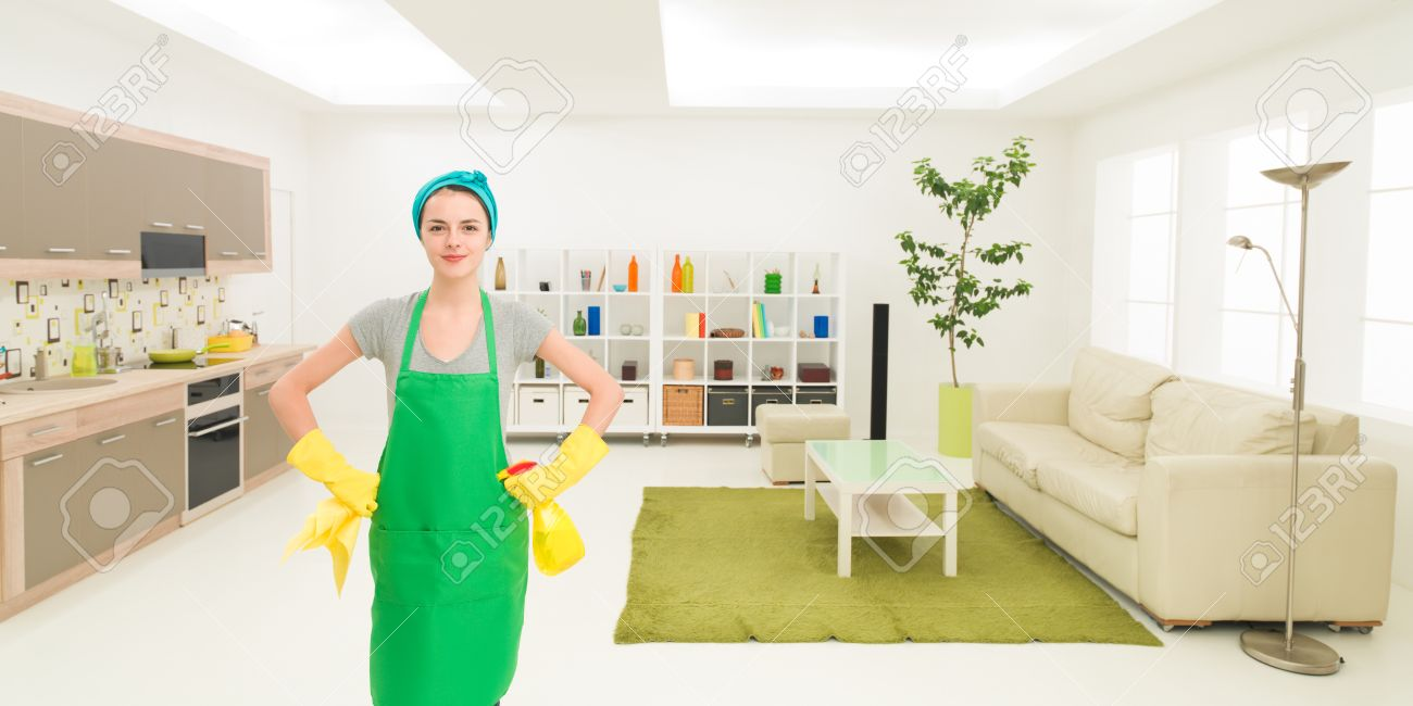 Marvelous Young Caucasian Proud Woman Standing In Clean House Holding Cleaning  Products Stock Photo   36920086