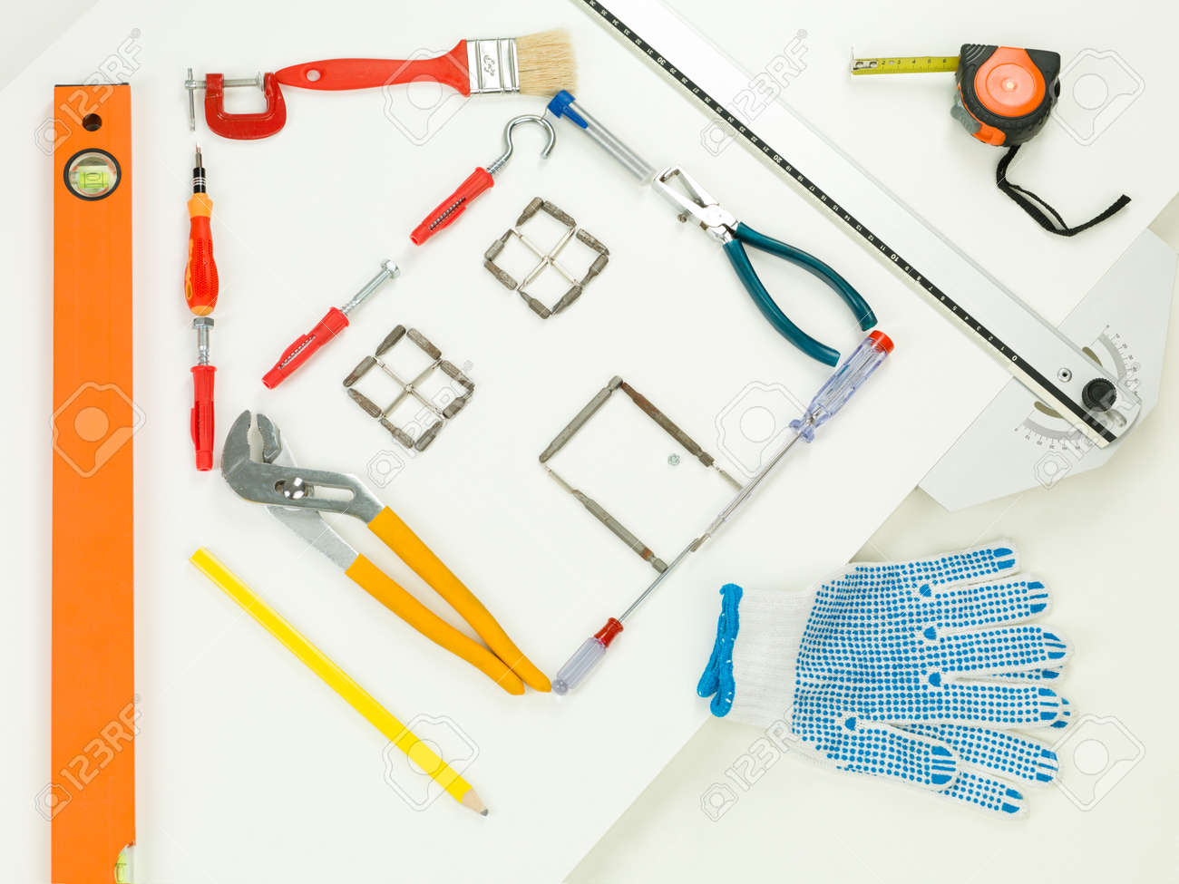 Shape Of House Made With Household And Construction Tools On Wiring White Background Perspective View