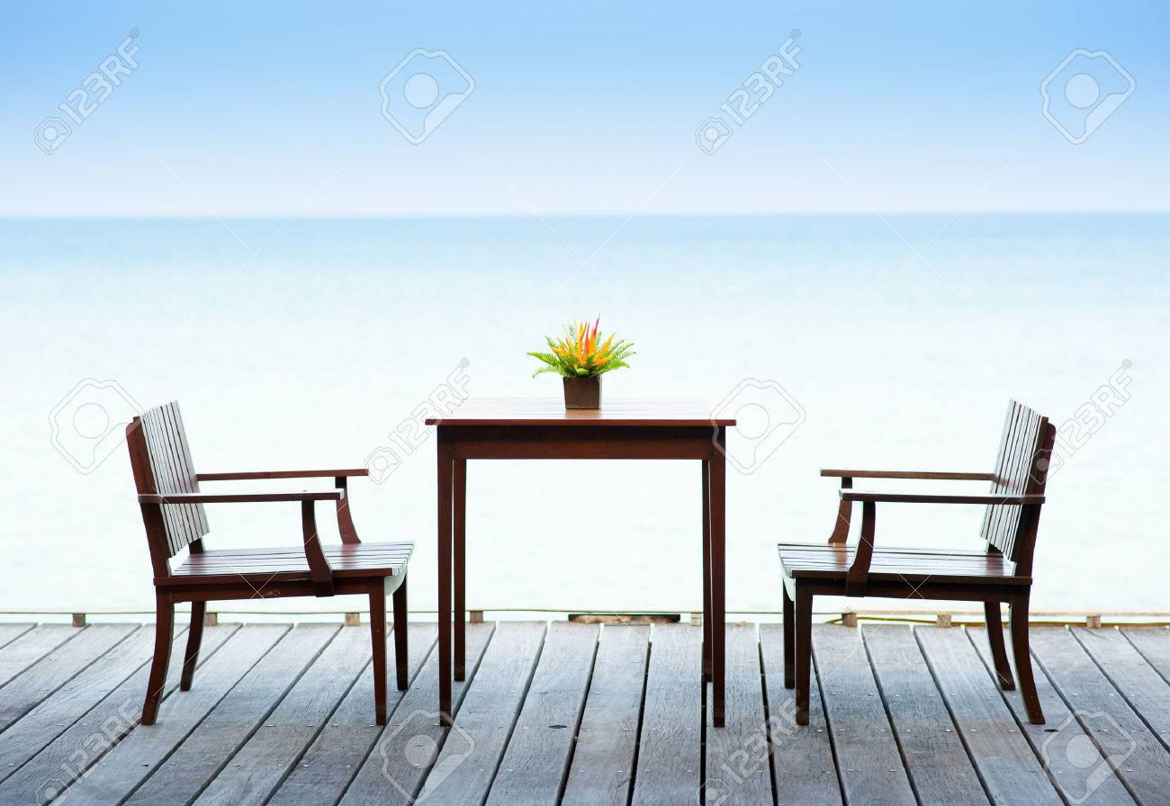Stock Photo   Terrace Sea View With Outdoor Wood Chairs And Table