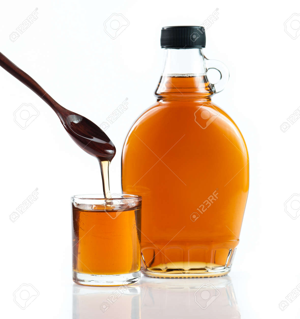 aab7dd1a7b6 maple syrup in glass bottle on white background Stock Photo - 48852605
