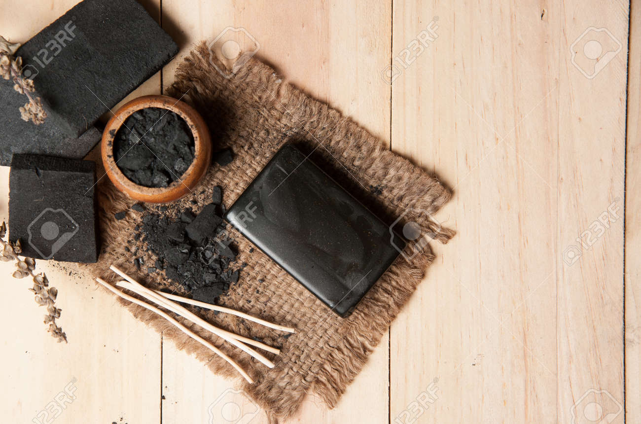 block of natural carbon soap and Black charcoal - 50381871