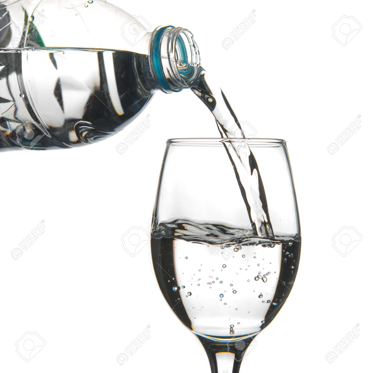 Water Pouring Into Wine Glass On White Background