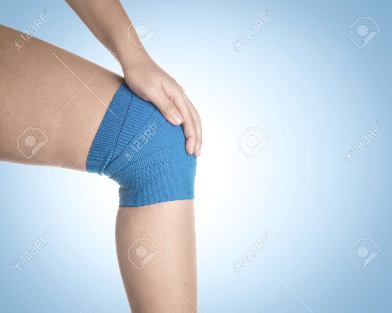 Knee Wrapped In Elastic Bandage On Blue Background Kree Pain Stock
