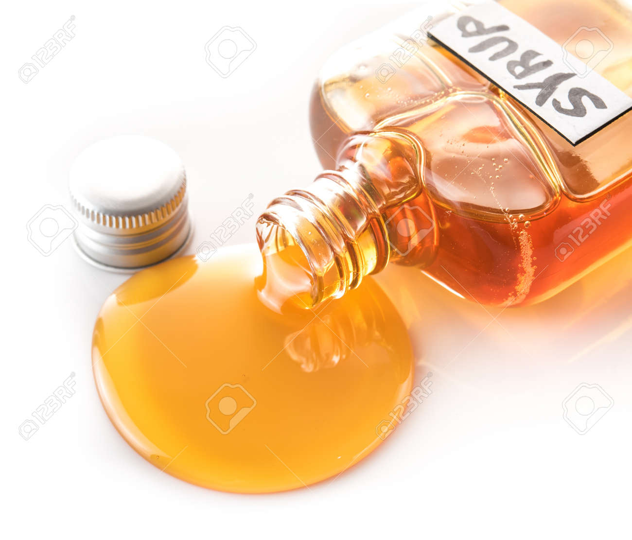 a51ec0ae784 Maple syrup bottle pouring on white background Stock Photo - 100606507