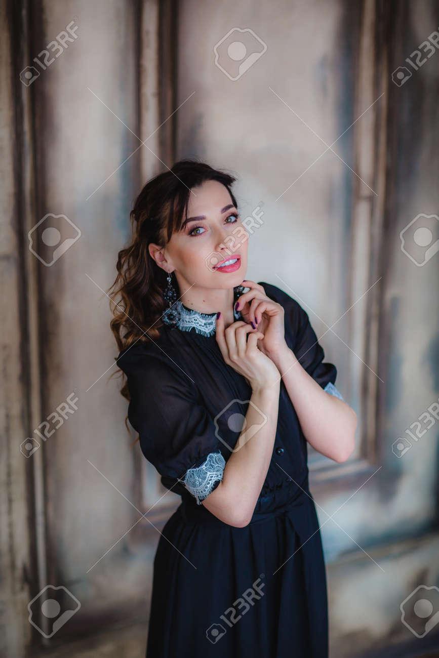 f90b8b1fe2 Pretty brunette model posing near art wall Stock Photo - 76132547