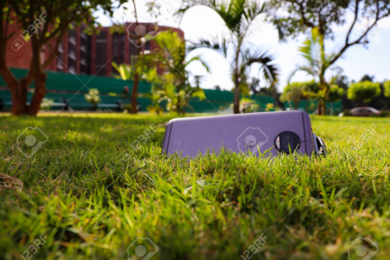 Mobile Phone Kept On The Grass And Clicked A Close Up Picture Stock Photo Picture And Royalty Free Image Image 116414098
