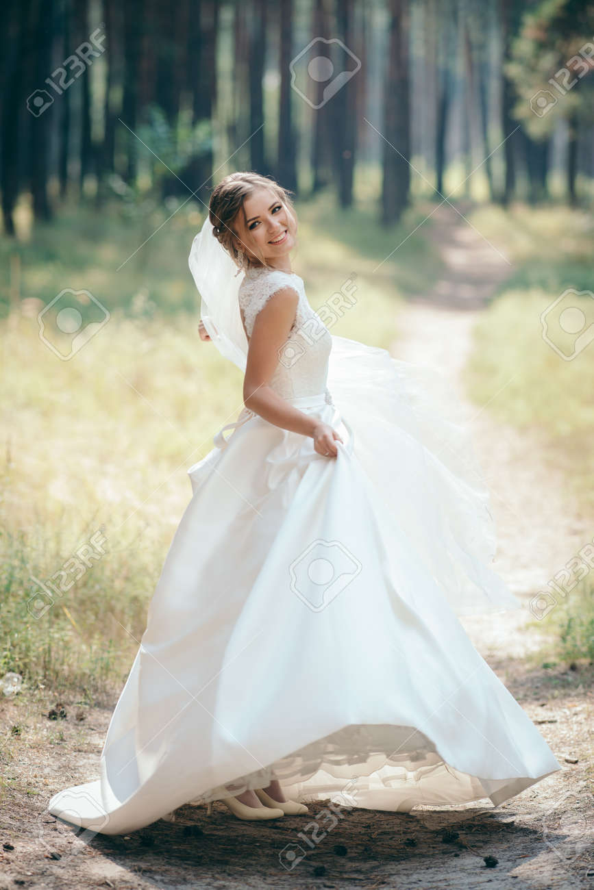 Beautiful Bride In Fashion Wedding Dress On Natural Background.The ...