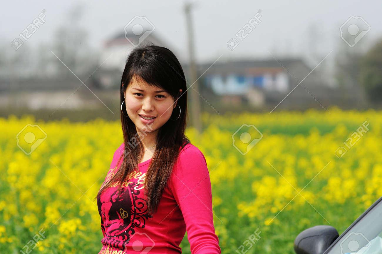 A Pretty Chinese Women In Rape Flowers Stock Photo 6311401