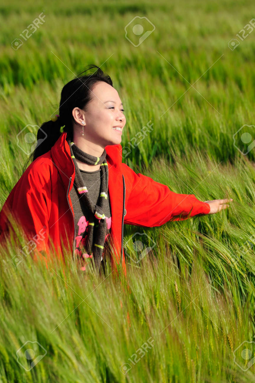 asian woman grass in red Stock Photo - 6566316