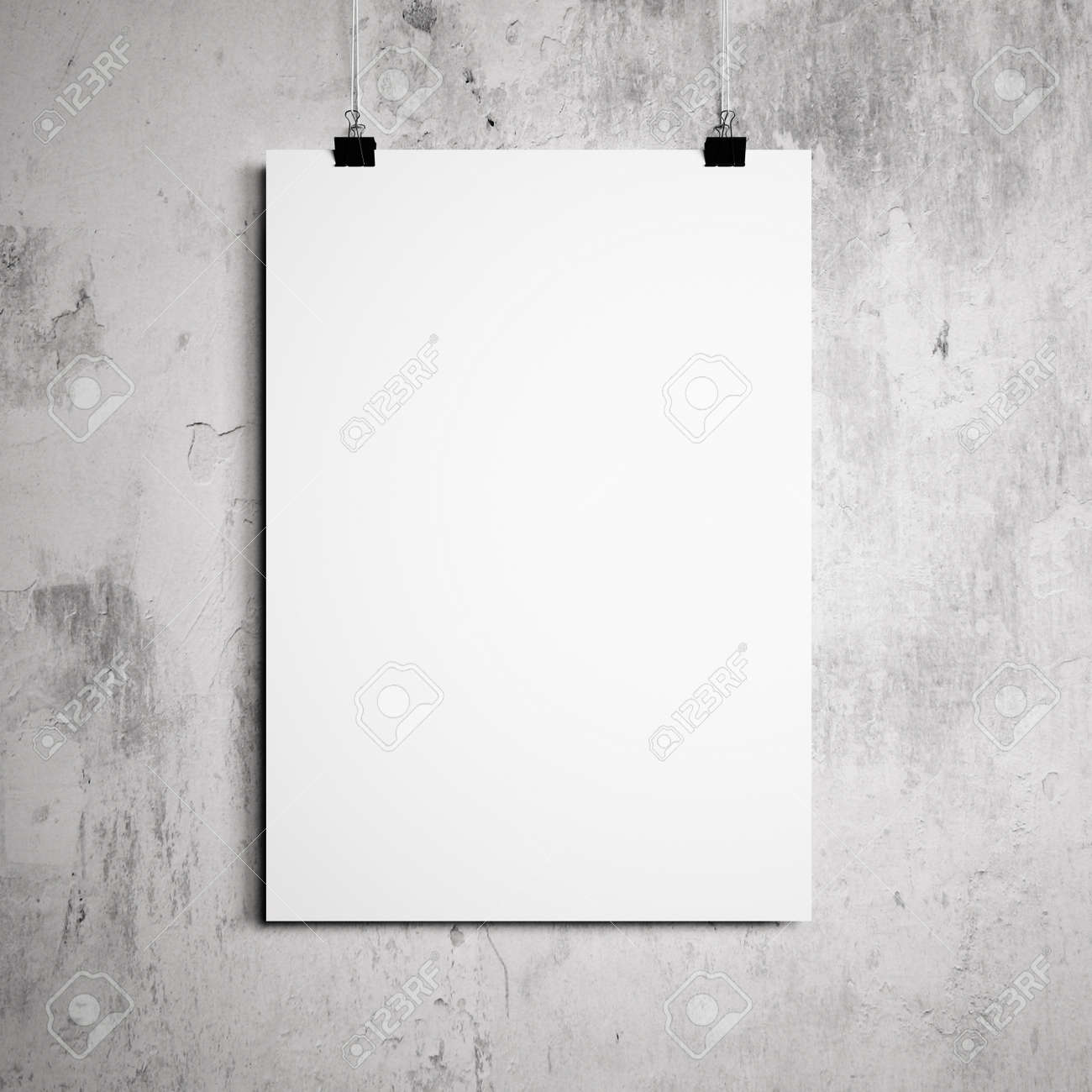 blank poster hanging on a white background painted walls stock photo