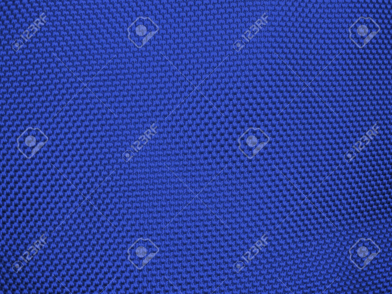 Knit woolen texture. Fabric blue background Stock Photo - 11032326