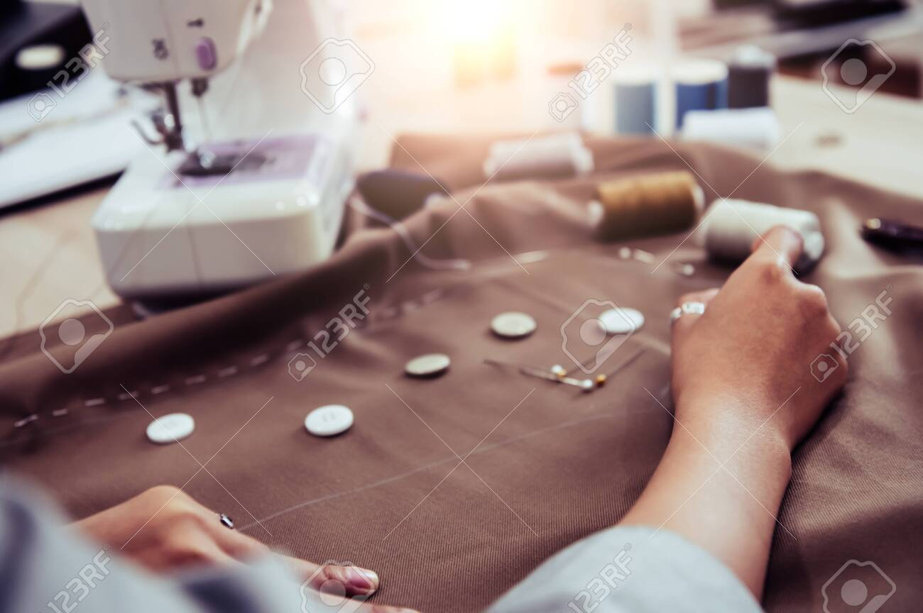 Dressmaker Designing New Fashion Dress Fabric With Sewing Machine Stock Photo Picture And Royalty Free Image Image 129402500