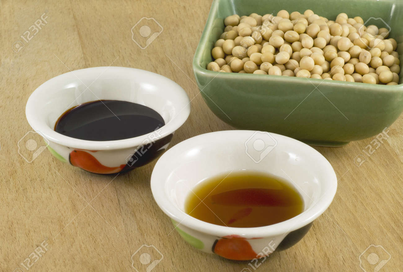 Thick and light soy sauce in ceramic dish and soy beans in green porcelain bowl. Stock Photo - 9179687