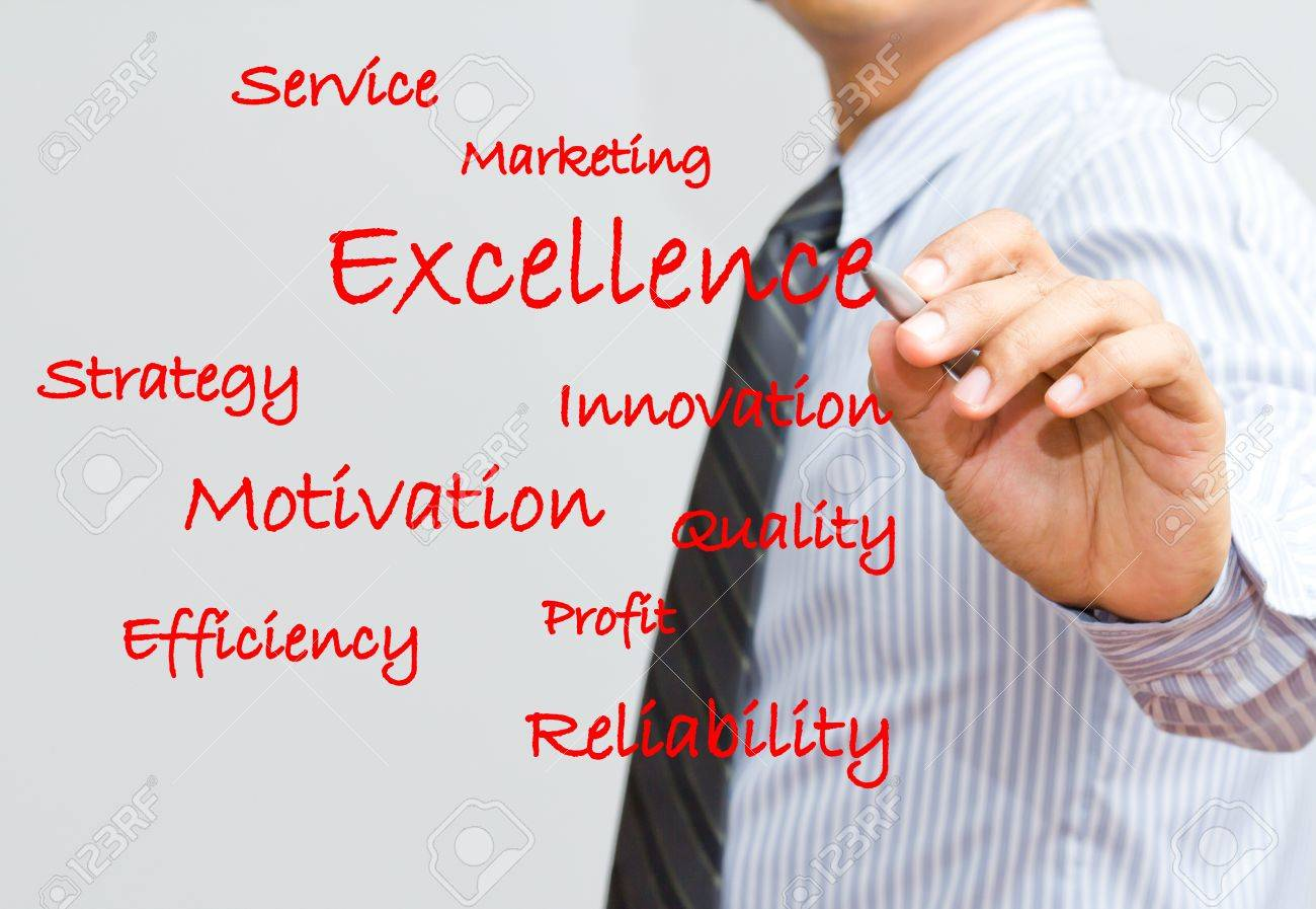 Businessman writing excellence and marketing wording Stock Photo - 15892048