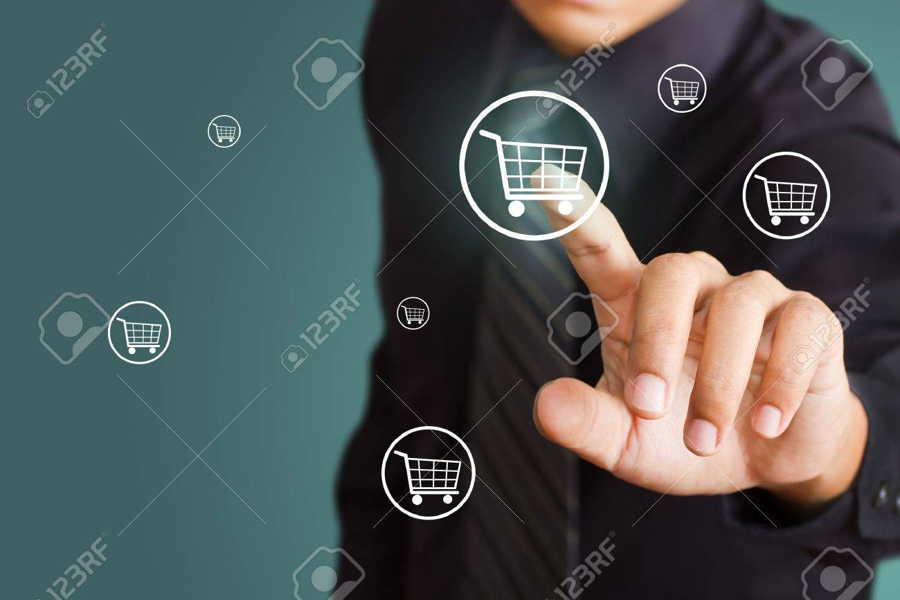 Business man pressing shopping cart icon Stock Photo - 15892058