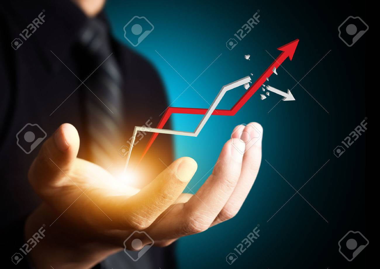 Hand holding a rising arrow, representing business growth - 23248879