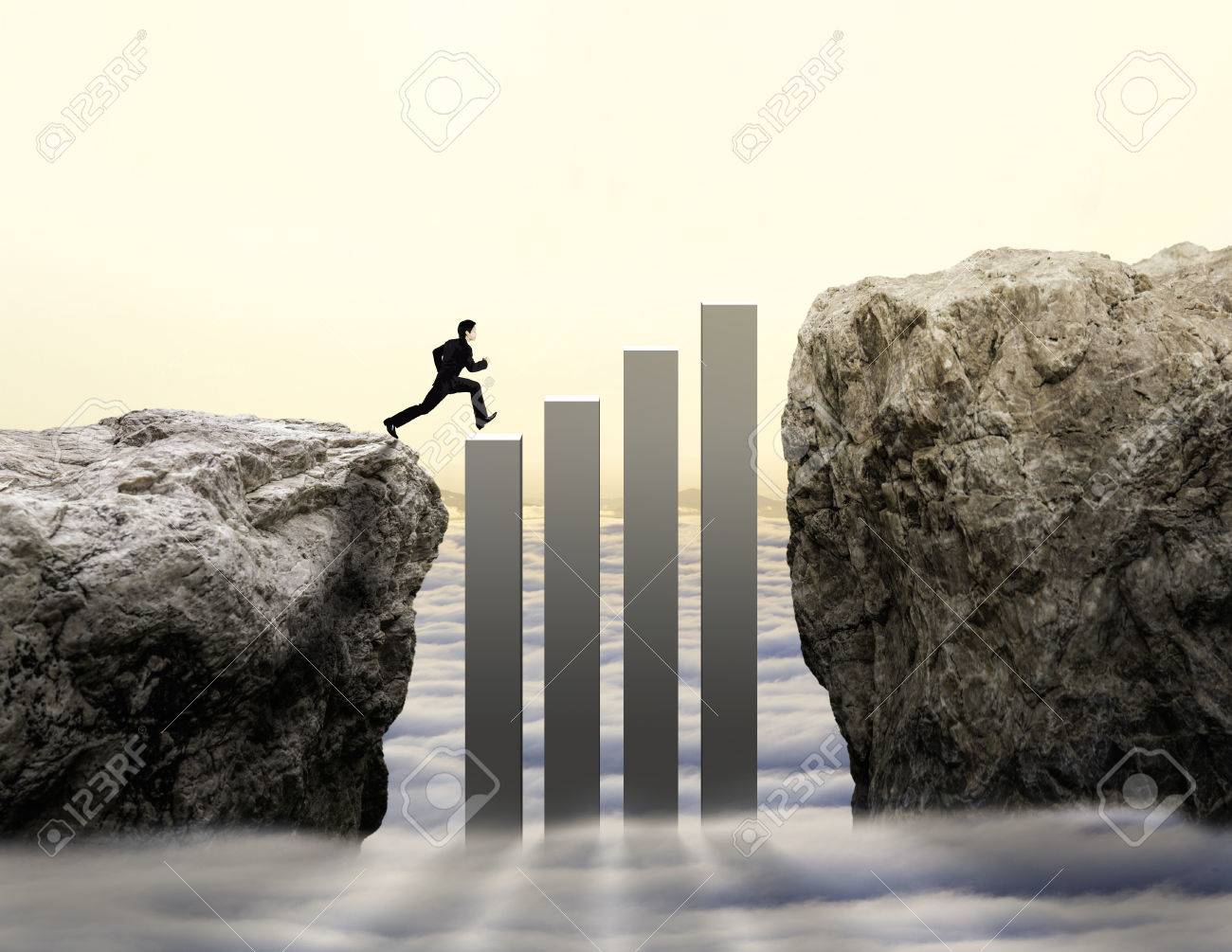 businessman jump across challenge with increasing graph - 66020091