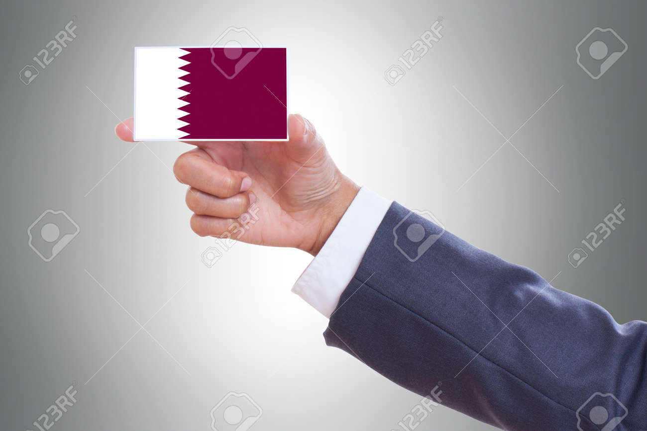 Businessman hand holding a business card with qatar flag stock photo businessman hand holding a business card with qatar flag stock photo 26349811 reheart Image collections
