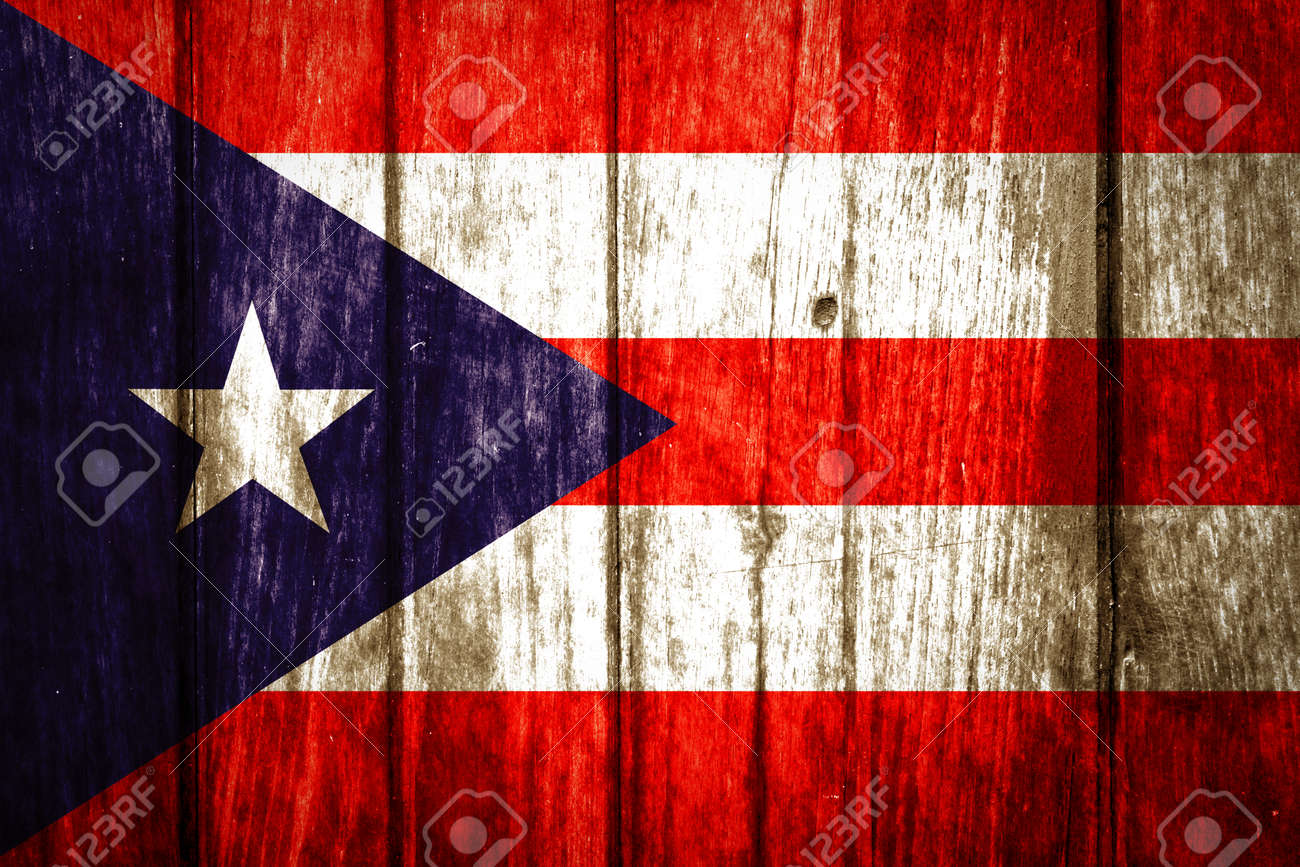 Puerto Rico Flag Painted On Old Wood Background Stock Photo
