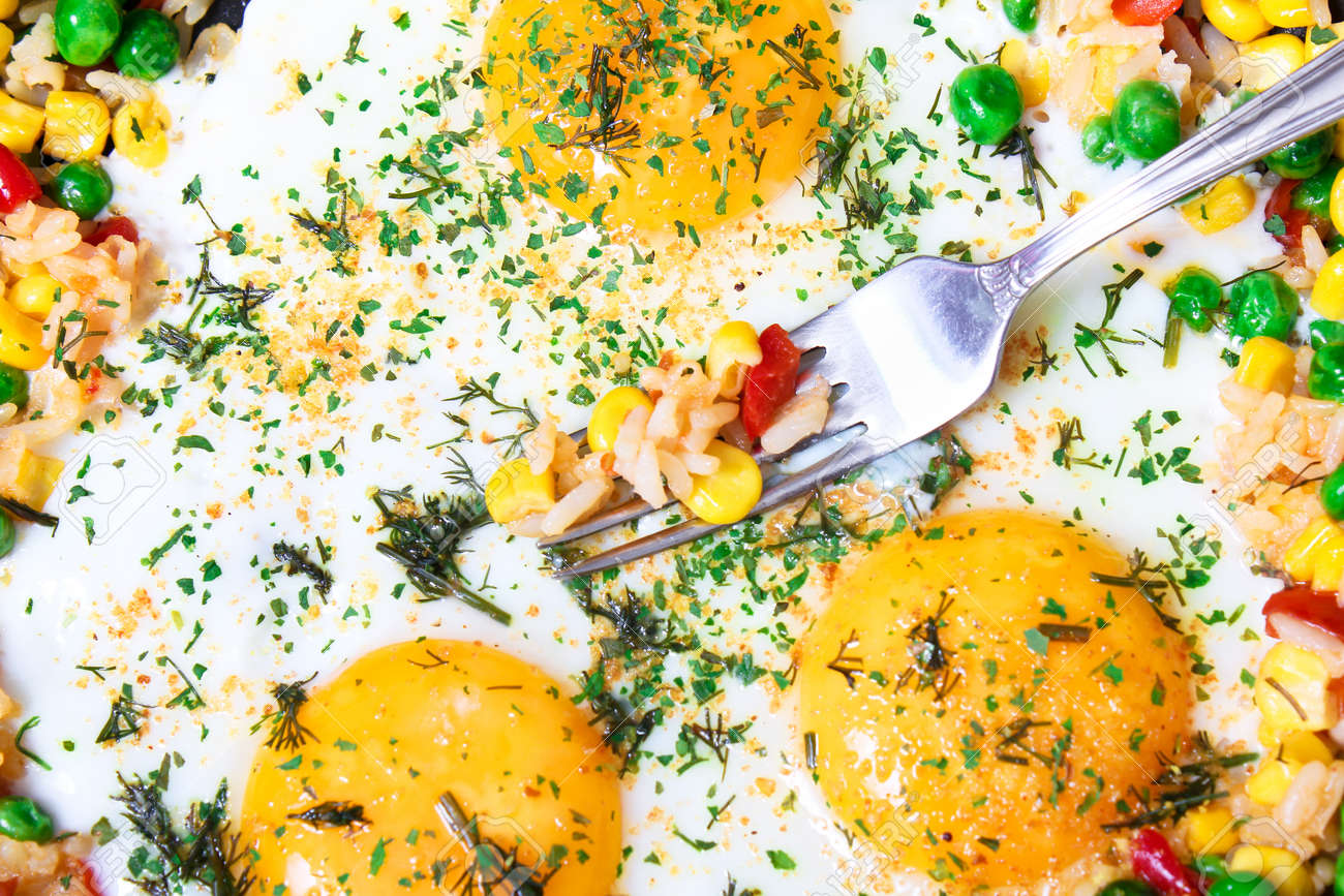 Fried eggs with vegetables, close-up Stock Photo - 9898165