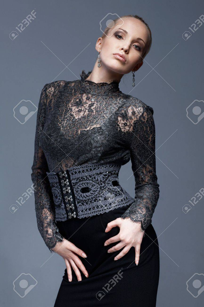Portrait of a beautiful model in black, lace blouse, posing. Stock Photo - 6908107