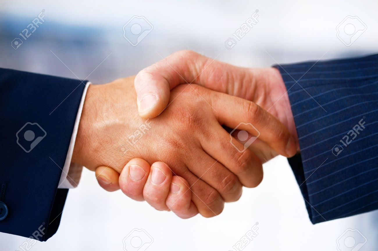 Closeup picture of businesspeople shaking hands, making an agreement. Stock Photo - 7234912