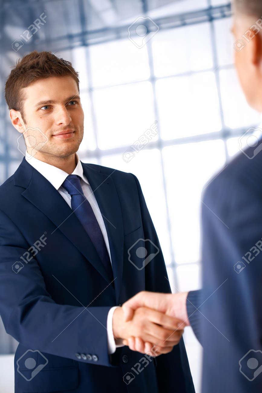 Business People Shaking Hands Coming To An Agreement In The Stock