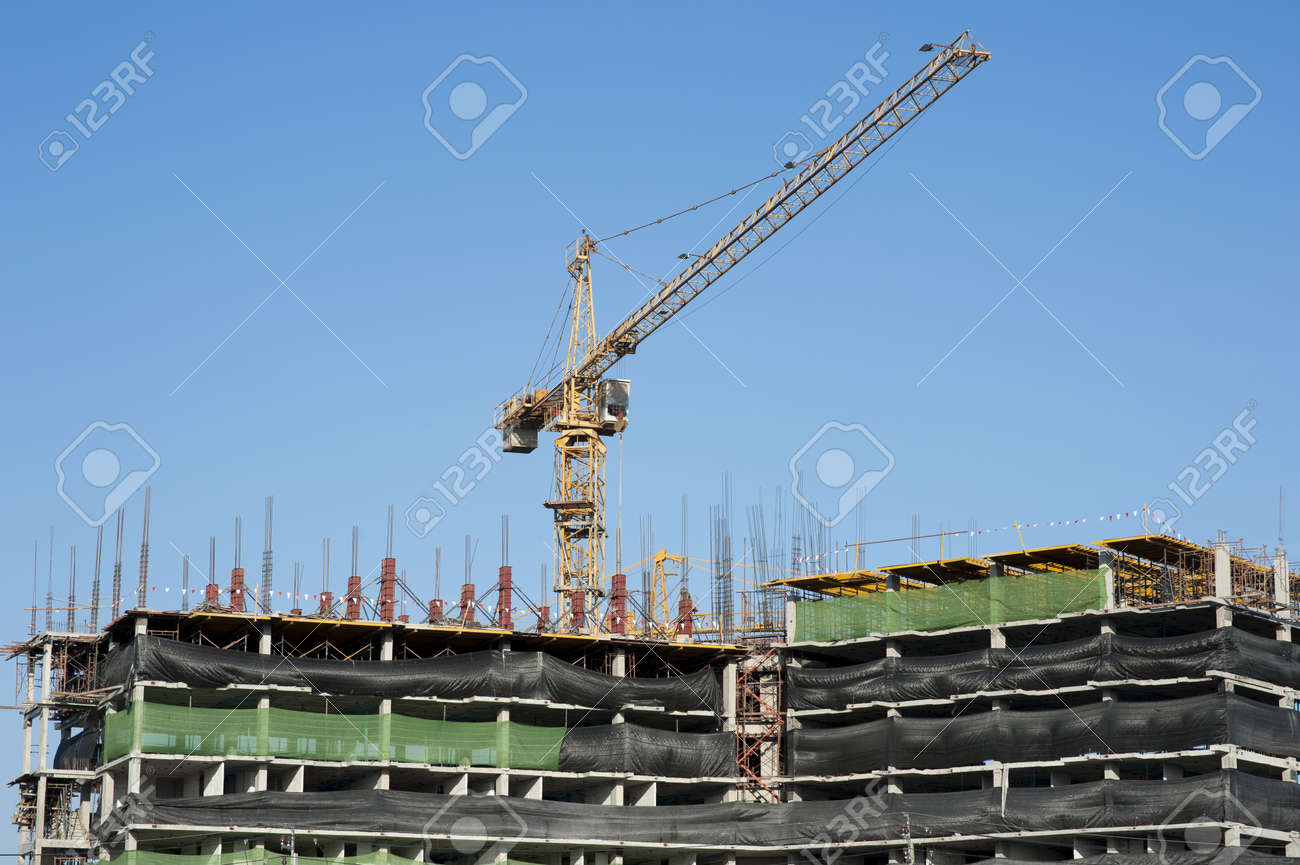 buildings under construction and cranes under a blue sky Stock Photo - 17209603