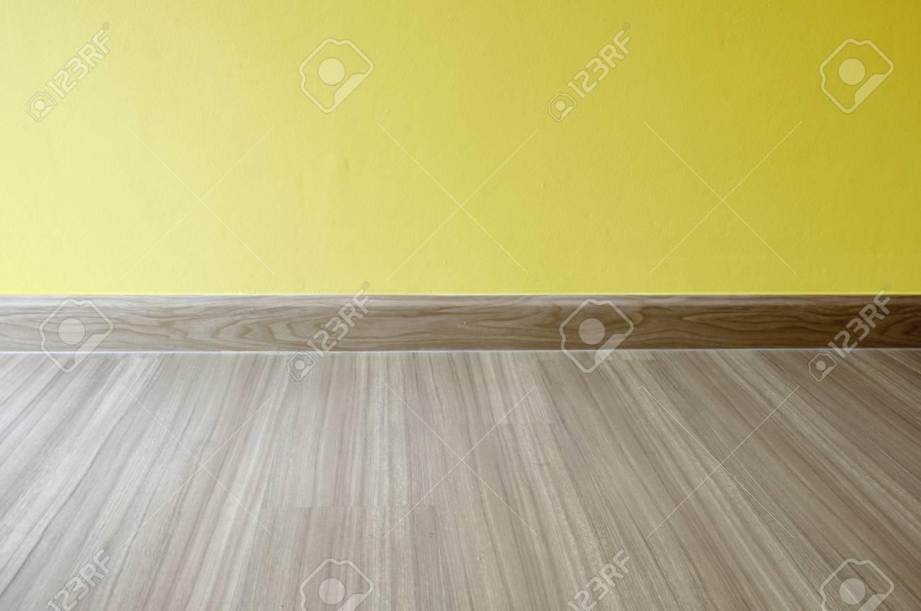 Empty Room Interior Oak Wood Laminate Floor And Yellow Wall
