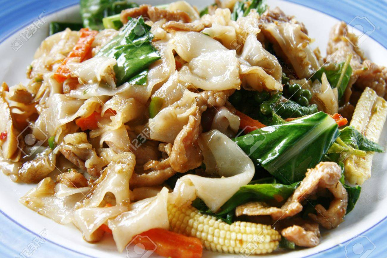 Spicy Thai stir fried broad rice noodles with pork and vegetables