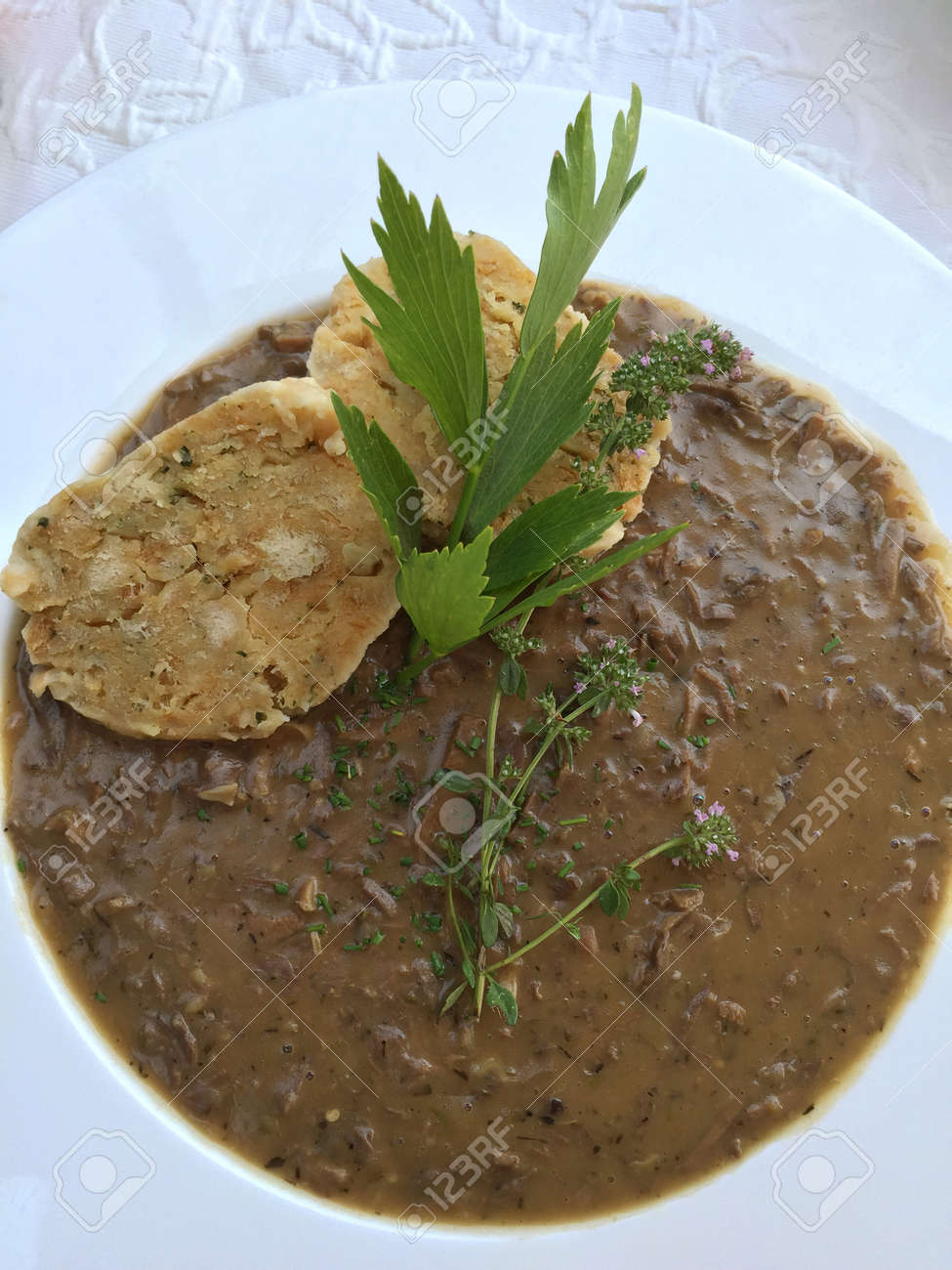 Old styled Viennese soup called Beuschel, a ragout made with veal lungs and heart, serve with bread dumplings in Austria Standard-Bild - 64922972